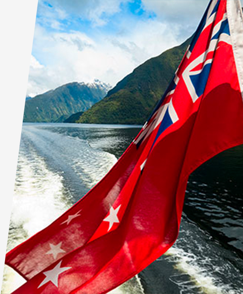 The New Zealand flag blows in the wind on the back of a boat