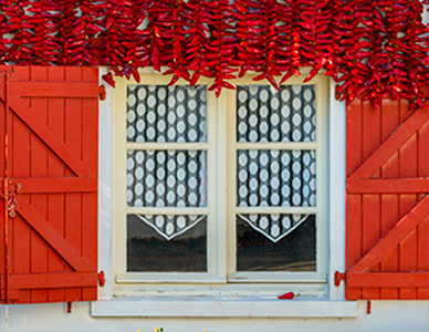 A white window sill on a red cottage in Basque Country