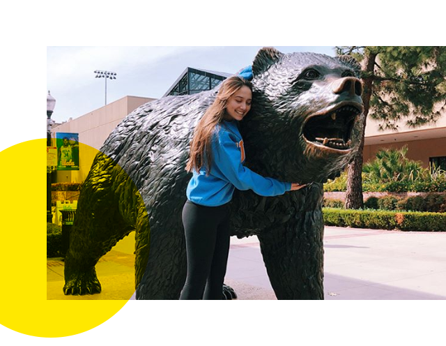 New student hugging The Bruin